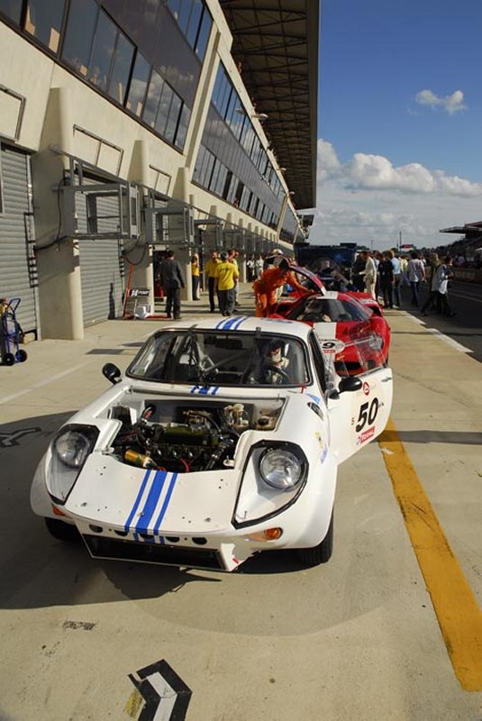 White Mini Marcos in pits